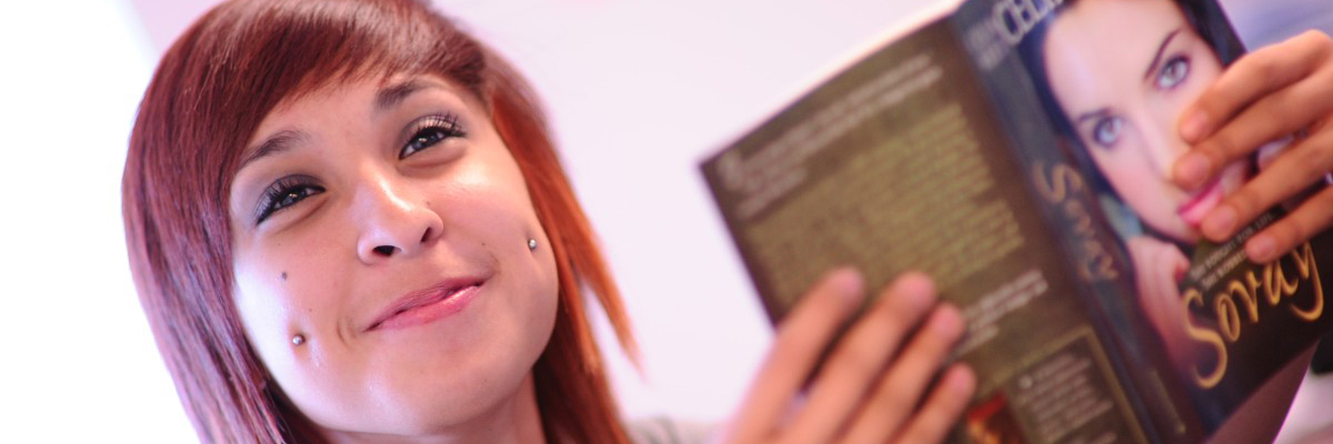 Female Ombudsman student holding a book